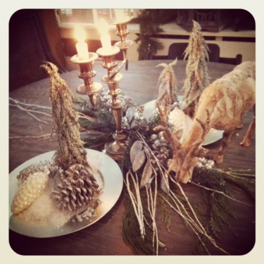 Pinecones, fake snow on my dining room table last year. ( This was another pretty, Cindy concoction.)