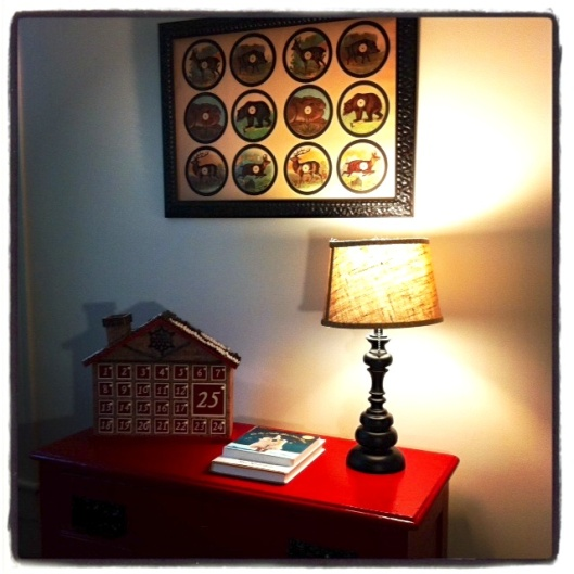 The print on the wall is actually an old  German shooting target that I found at my cousin's antique store. I love how quirky and odd it is.