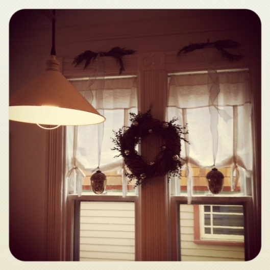 More kitchen windows. You'll never guess where that pretty faux wreath is from!