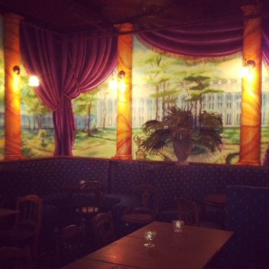 The room off the bar. Love the mural- hope that makes the cut.