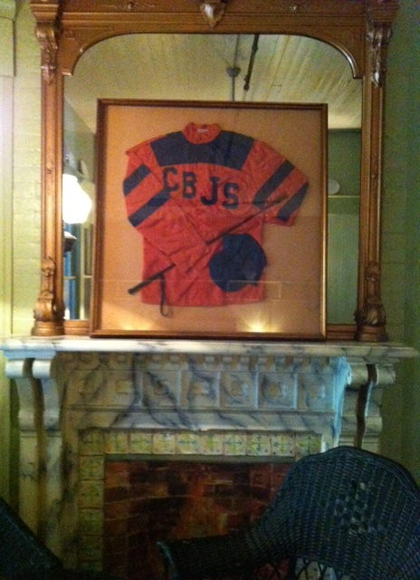 Love this too- hope they leave it as is. Hip bars in NYC would kill for this... looks like it was framed on the cheap in the 60's with a cheap gold frame. But it just works.