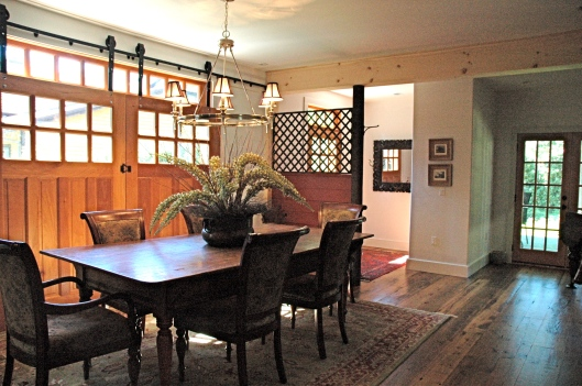 The Dining Room. Those custom barn doors open on to a small courtyard- awesome in the warm months.