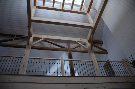 Looking up from the living room through the new cupola. The framework, although aesthetically complete, was designed to eventually support a small staircase and little roost of a room with a glass floor. Maybe the new owners will complete it.