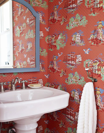 Powder room hung with vintage wallpaper.