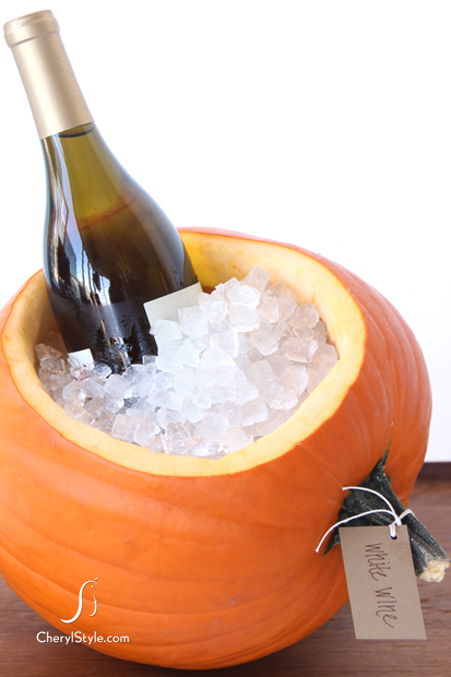 I don't know about you, but I definitely have month-old pumpkins on my porch still.(Hey- they're good through Thanksgiving!) Well, turn one or two into a festive ice bucket!