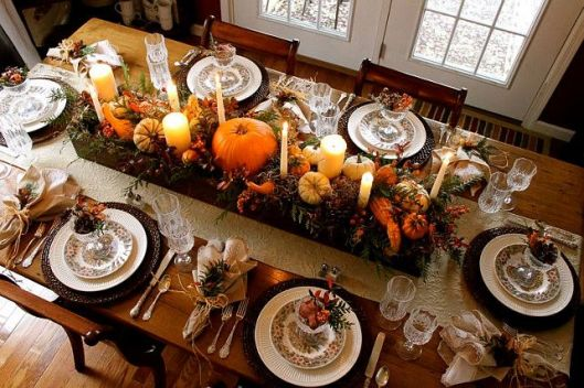 This is your traditional orange, brown, and yellow table done in a classically elegant way. It just exudes warmth and totally feels like a harvest feasting table.
