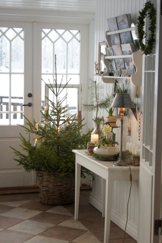 I borrowed from this look for my own front porch, filling a basket with greens left over from our tree and some lit LED branches.